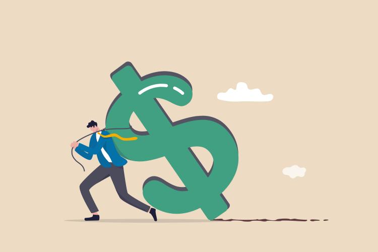 A man dragging a dollar sign
